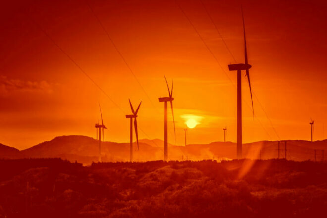 Wind turbines in front of a setting sun