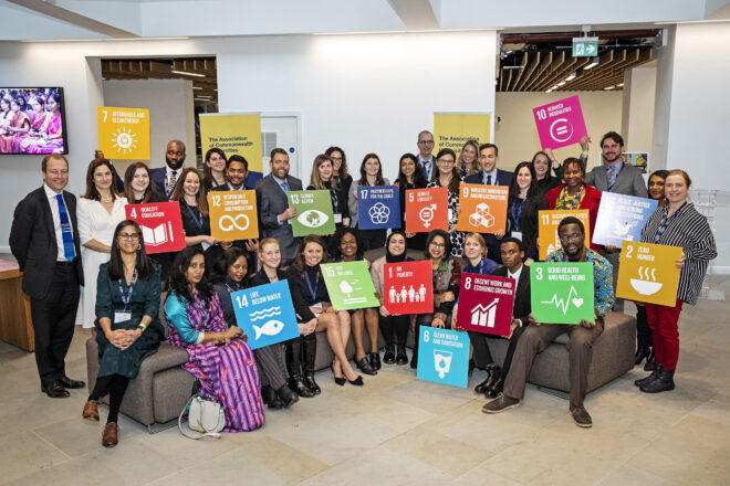 Staff, scholars and members of the Association of Commonwealth Universities holding placards relating to the Sustainable Development Goals