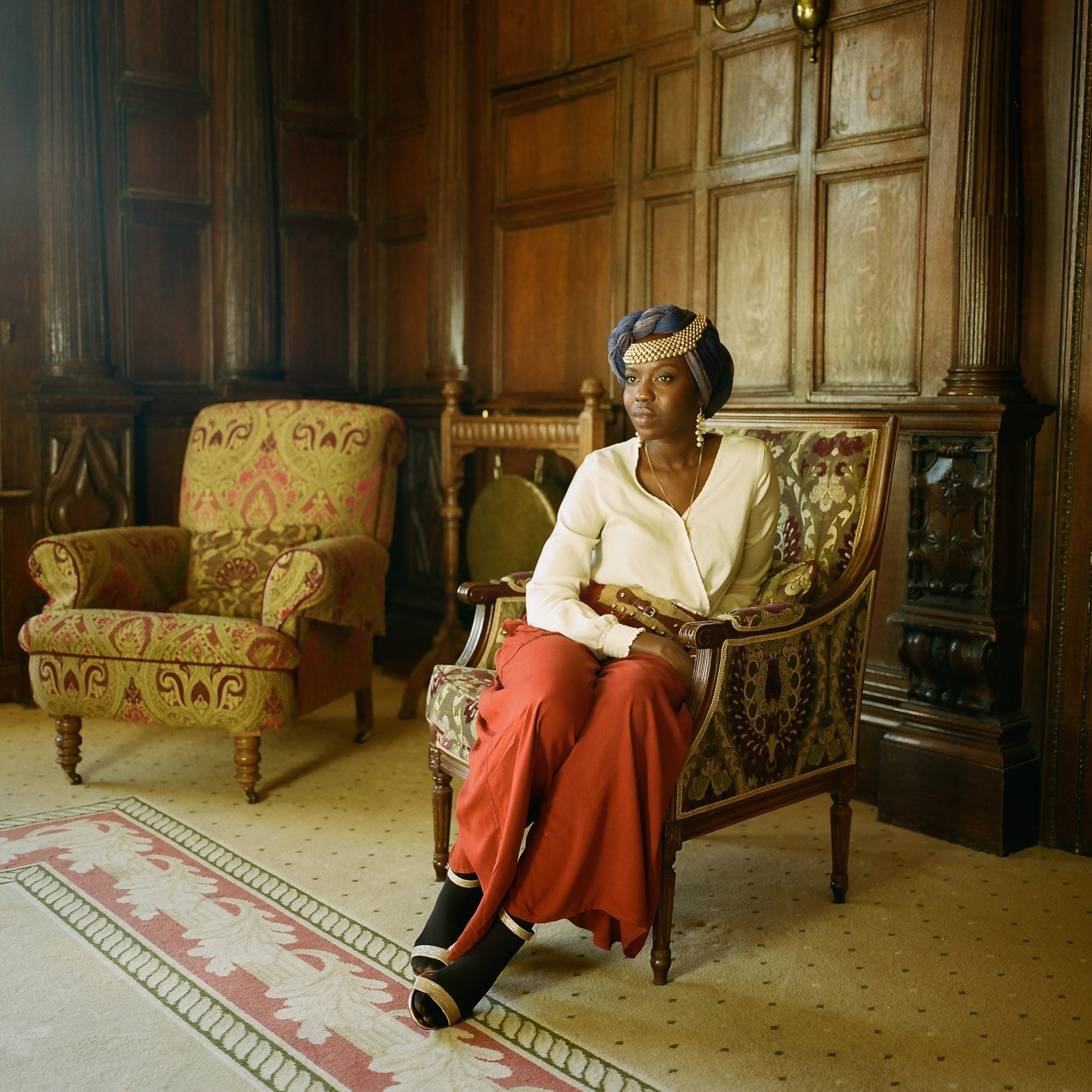 Emi Mahmoud sitting on a chair at Wilton Park