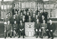Participants from a Wilton Park conference in the 1960s appearing in front of Wiston House.
