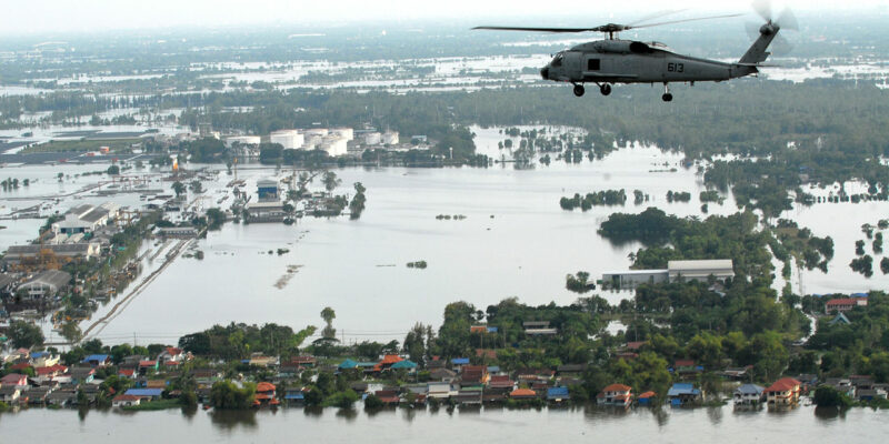 Helicopter flying over a flooded town in Greater Bangkok