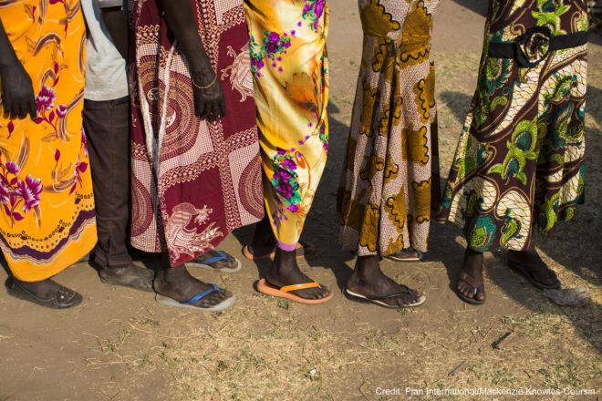 Women waiting in line at a food distribution in Nimule South Sudan