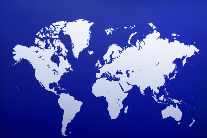 World map with blue background and land in silver