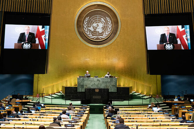 The Assembly Hall at the United Nations with Boris Johnson appearing on a large screen