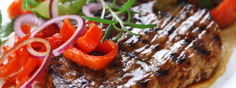 An example of the food provided by Wilton Park. This images shows steak served with a salad.