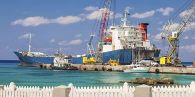 Barge anchored at commercial dock in Grand Cayman, Cayman Islands