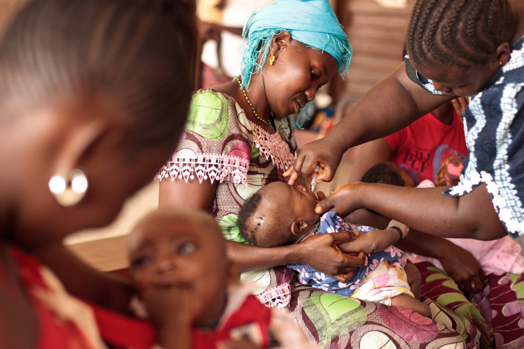 A young child receiving a vaccination.