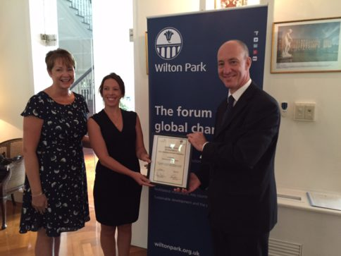 Devanna de la Puente being presented with the Marsh Award by British Ambassador to Thailand, Mark Kent